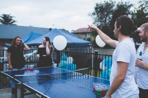 Friends Playing Ping Pong with Balloon