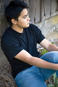 A shot of an asian male sitting alone