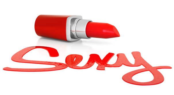 """Sexy"" written in red lipstick on white background."
