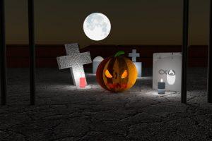 Jack-O-Lantern in a cemetery.