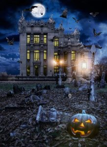 Haunted house with a cemetery and Jack o' lantern.