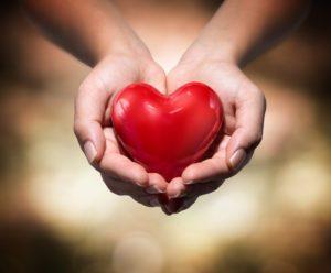hand-holding-heart1-300x248