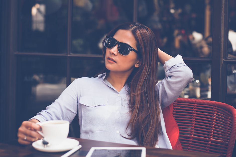 Young Single Woman With Glasses at Cafe