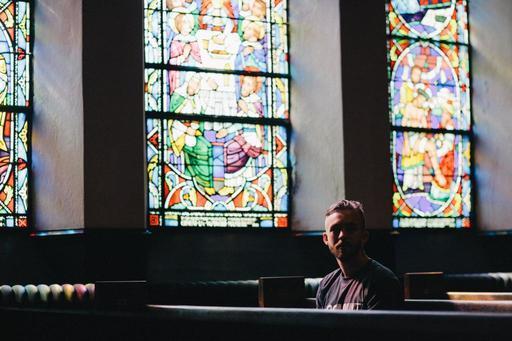 Single Christian in a Church Pew