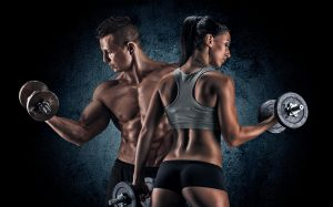 Fit Couple Lifting Weights Together