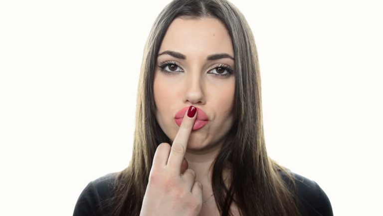 Photo Via: www.shutterstock.com, woman with middle finger, woman flipping someone off, woman pissed off, red nail polish.