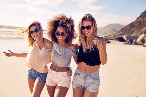 Three Girl Friends walking on Beach