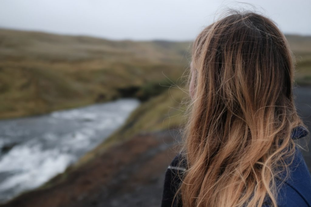 Photo Via: https://unsplash.com/@isuruperera, mental health, woman reflecting in nature, woman with brown hair looking into distance.