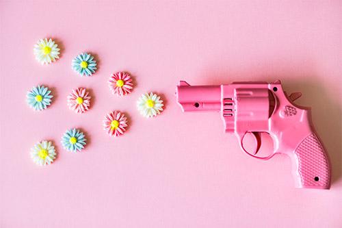 pistol whipped pink gun flower