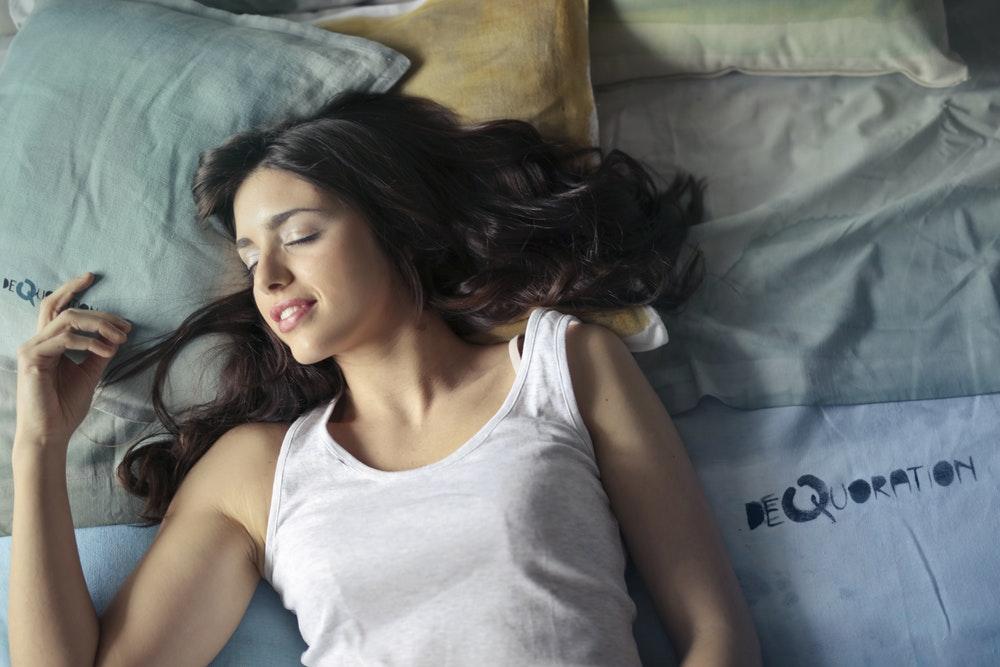 happy woman sleeping in bed