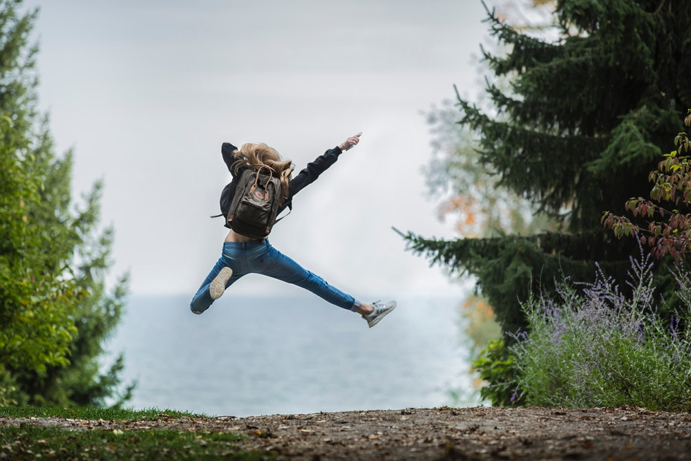 happy single woman jumping for joy