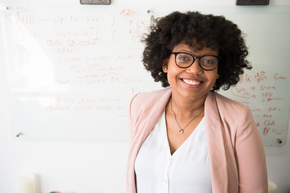 smiling woman with afro