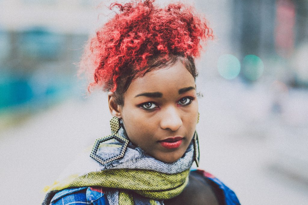 woman with red hair blurry background