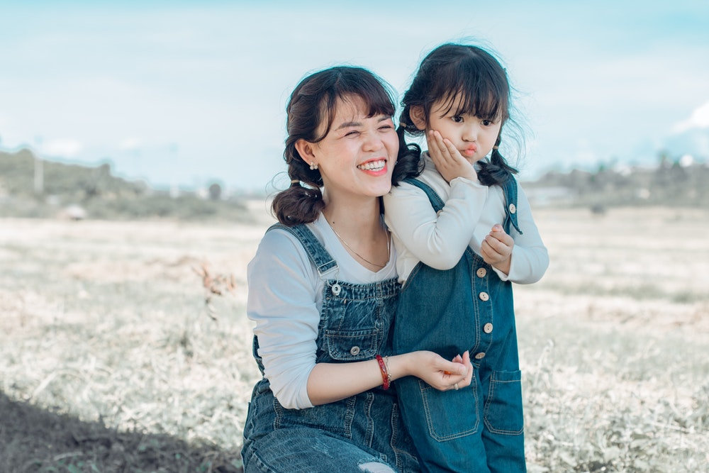 single mom with little girl meadow