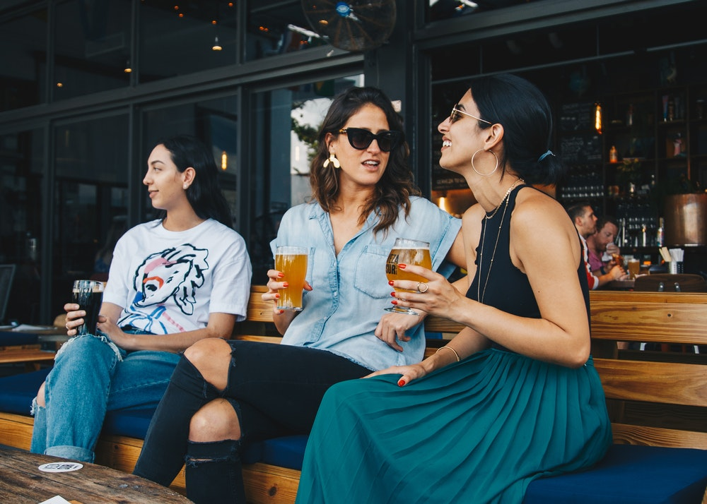 women drinking beer for bachelorette party