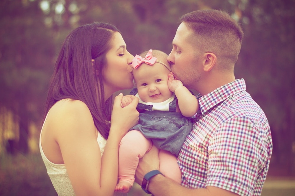 happy family kissing
