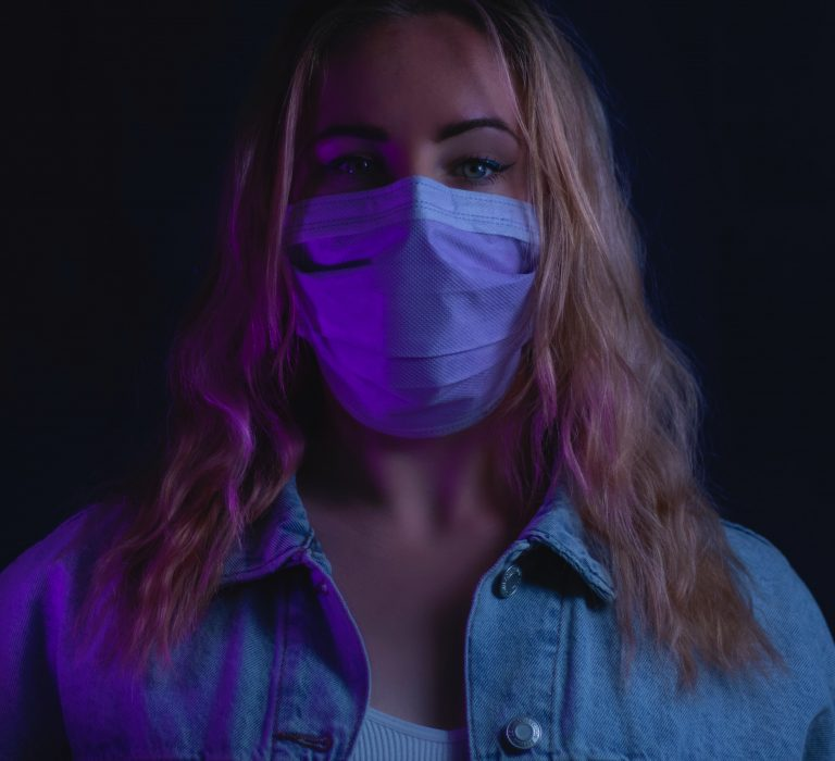 Blonde woman wearing mask during coronavirus pandemic